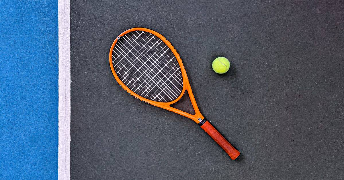A close up of a ball with a racquet