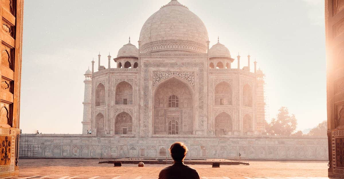 A person standing in front of Taj Mahal