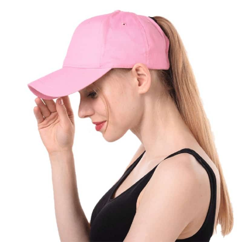 A woman wearing a pink hat