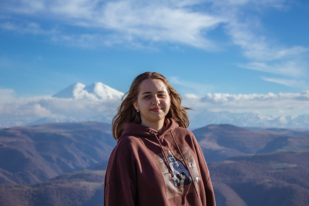 A person standing in front of a mountain