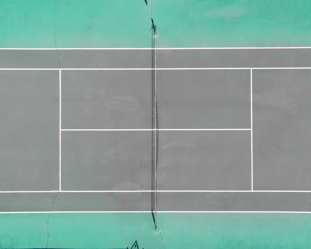 A person on a court with a racquet
