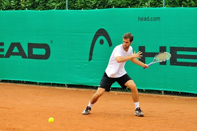 A person swinging a racket at a ball